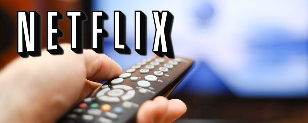 Netflix logo over image of remote control being used